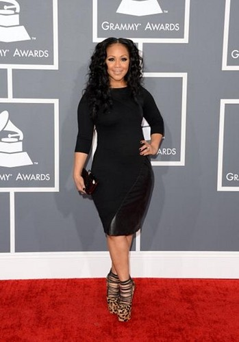 Erica Campbell poses on red carpet at 55th annual Grammy Awards in Los Angeles, California February 10, 2013