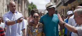 Beyonce sports a braided updo and cultural attireas she and hubby Jay-Z celebrate their fifth anniversary in Cuba!