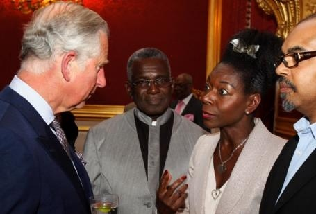 HRH Prince Charles chats with Baroness Floella Benjamin, while actor Rudolph Walker looks on