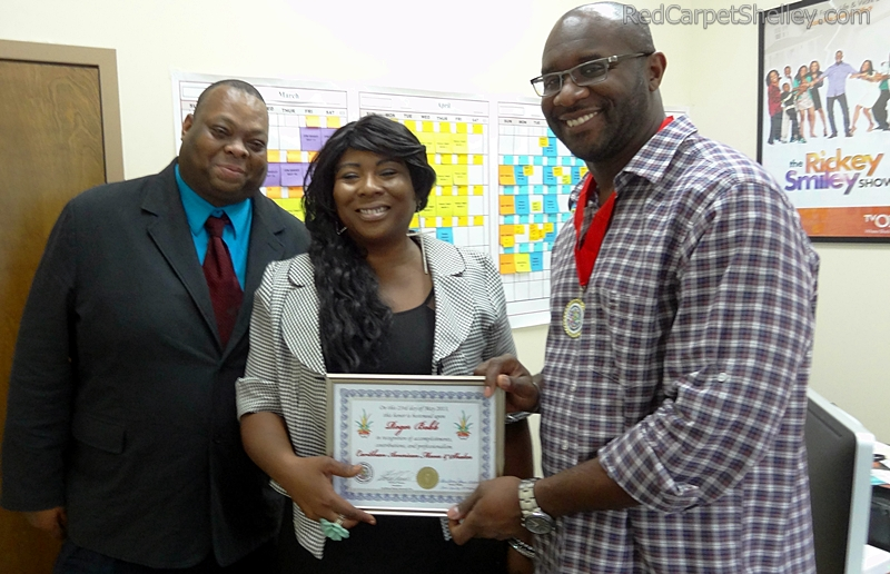 Michael Thomas and Red Carpet Shelley present Roger Bobb with Caribbean Movers and Shakers award