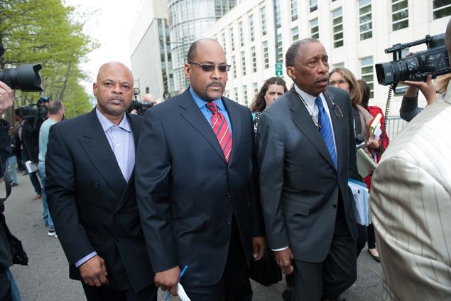 Brooklyn State Senator John Sampson (center) and his attorney Zachary Carter (right) leave Brooklyn Federal Court on Monday