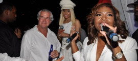 Myx Fusions co-owner Mona Scott-Young makes remarks aboard the Aqua Azul as CEO Peter Reaske and partner Nicki Minaj look on
