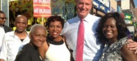 Former NYC Councilwoman Una Clarke, l, with her daughter, Congresswoman Yvette Clarke and Mayor Elect De Blasio at a campaign rally in the summer. (FILE Photo)