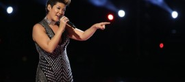 """n this photo provided by NBC, Tessanne Chin sings during the season five finale of """"The Voice"""" on Tuesday, Dec. 17, 2013, in Los Angeles. Chin was announced the season five winner. The 28-year-old Kingston native had nearly given up on her dreams before landing a spot on the NBC singing competition. Chin's coach, Maroon 5 frontman Adam Levine, was also thankful to add a second win to his resume. (AP Photo/NBC, Tyler Golden) (The Associated Press)"""