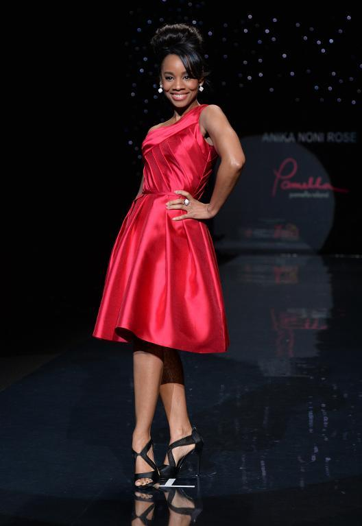 Anika Noni Rose presents a dress by Pamella Roland during The Heart Truth Red Dress Collection show in New York on February 6, 2014 (AFP Photo/Stan Honda)