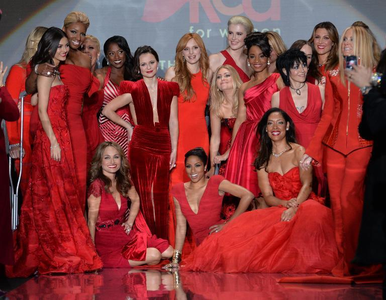 Models gather at the end of The Heart Truth Red Dress Collection show in New York on February 6, 2014 (AFP Photo/Stan Honda)