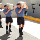 Sailors from HMS Argyll with some of the seized drug bales.The Royal Navy issued this picture with their faces obscured.