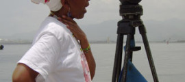 "Cuban Filmmaker Gloria Rolando, On location in Haiti, shooting the 2014 film, ""Reembarque/Reshipment"""