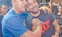 DOUBLE TRIUMPH: Chutney Soca Monarch and Traditional Monarch champions Rikki Jai (Samraj Jaimungal) and Ravi B (Ravi Bissambhar) celebrate after being crowned at Skinner Park, San Fernando on Saturday night. —Photos: DEXTER PHILIP