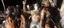 One Island Masqueraders (50 Shades of Grey) cross the stage at 2015 Miami Carnival