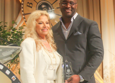 Suzanne de Passe accepts her Legendary Award from film producer Roger Bobb