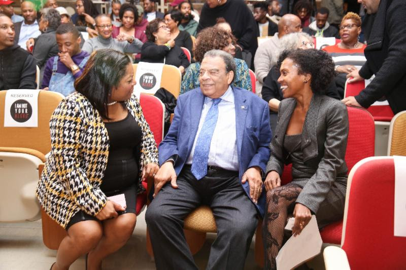 Ambassador Andrew Young chats with a guest and Dr. Dunn
