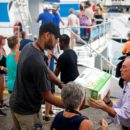Michael Bloomberg and Tim Duncan help unload supplies from a boat in St Jonh, U.S. Virgin Islands, on Thursday, September 14, 2017. Photographer: Michael Nagle/Bloomberg