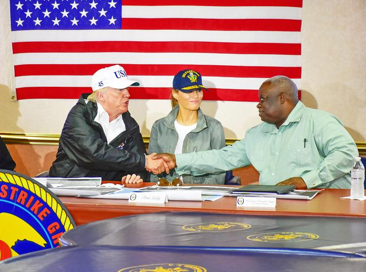 Governor Kenneth Mapp (right) meets with President Donald Trump and First Lady Melania Trump on Tuesday.